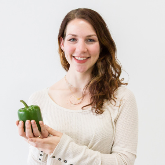 Meghan Peoples holding an organic pepper