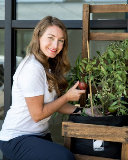 Brie Arthur With a Tomato Plant