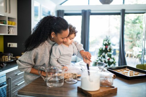 Mom preparing holiday recipes with child
