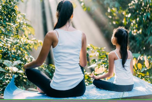 Mother & Daughter Meditating