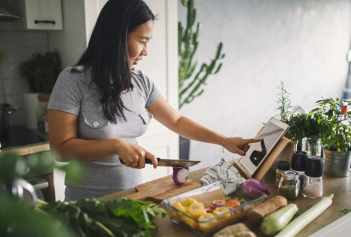 Woman Cooking Healthy Food in Kitchen