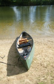 A canoe on the banks of the River Thames