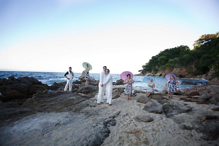 two-men-beach-umbrellas