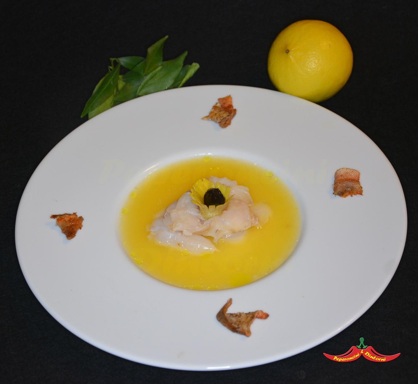 Fiore di Scorfano, e la sua pelle, marinato al Bergamotto e olive nere al forno