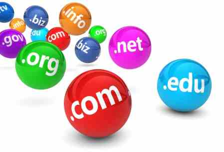 Website and Internet domain names web concept with domains sign and text on colorful bouncing glossy spheres isolated on white background.