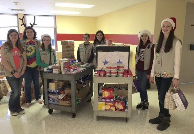 Girl Scout Troop Stocks Veterans Home Pantry