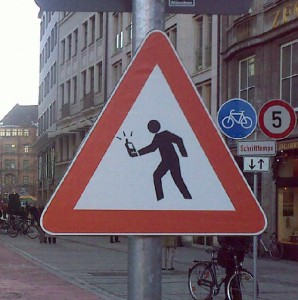 warning sign for mobile using pedestrians in Munich