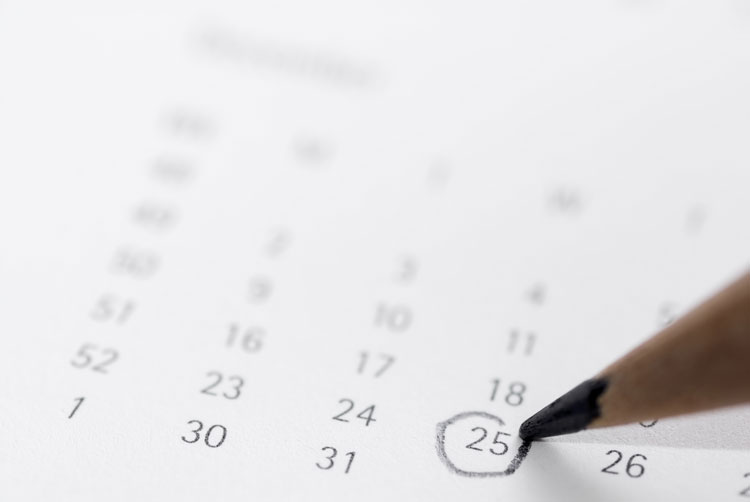 a calendar with Christmas Day circled in pencil