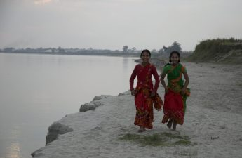 girls dancing on river bed