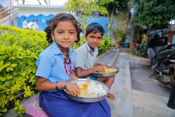 Students enjoying Mid day meal supported by Akshaya Patra