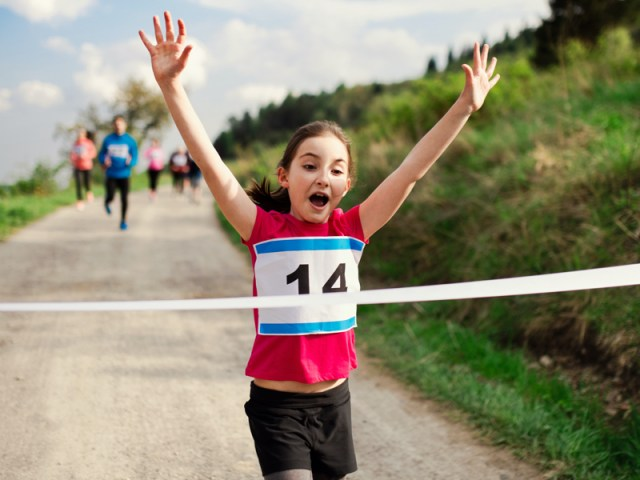 Gen z runner crossing finishing line