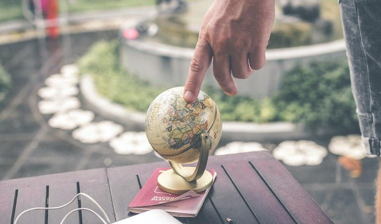 small globe and passport