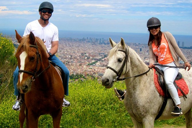 Two people on horses during a horseback riding tour near Barcelona.
