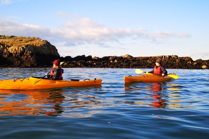 Two people kayaking in Dalkey, Dublin.