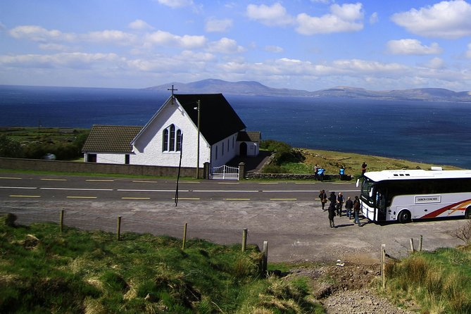 A bus tour stopped along the coast to enjoy the view during a Ring of Kerry tour
