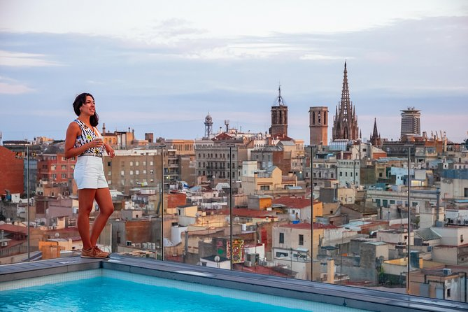 Woman on rooftop patio in Barcelona.