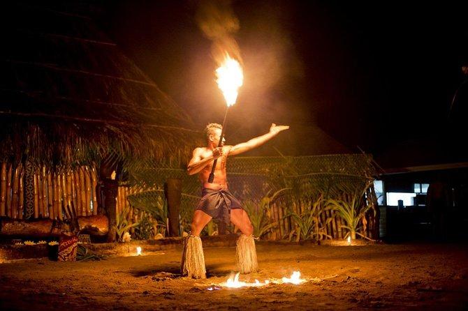 Fijian fire dancer in Fiji village.