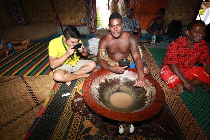 People drink kava during a sevu-sevu ceremony on a trip to Fiji