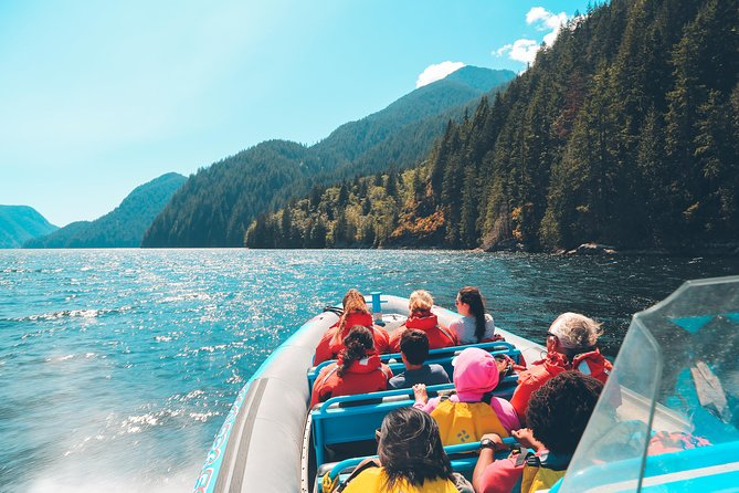 A group of people in a Zodiac boat taking a tour of Granite Falls, Vancouver.
