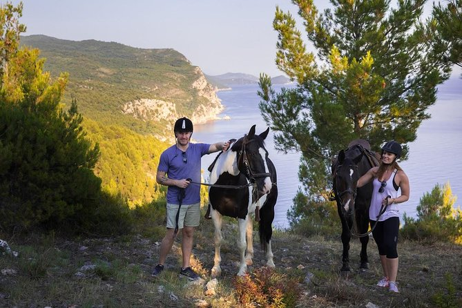 Two tourists exploring the coast near Dubrovnik by horseback.