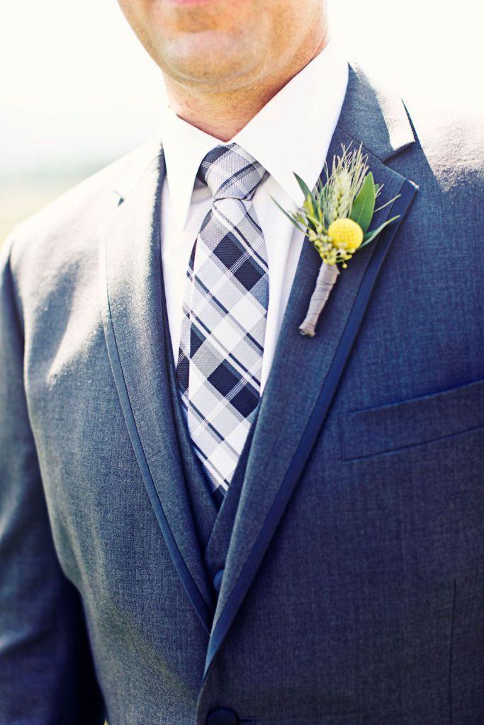groom in plaid tie