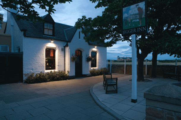 Jigger Inn by night. The famous pub is a favourite hangout for celebrities and local students.