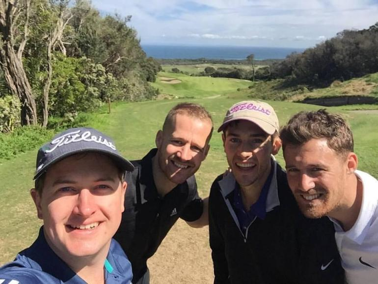 Jonathan (left) with his golf buddies having a good time on the course
