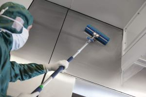 Cleaning Panel in Cleanroom with Extended Mop Handles
