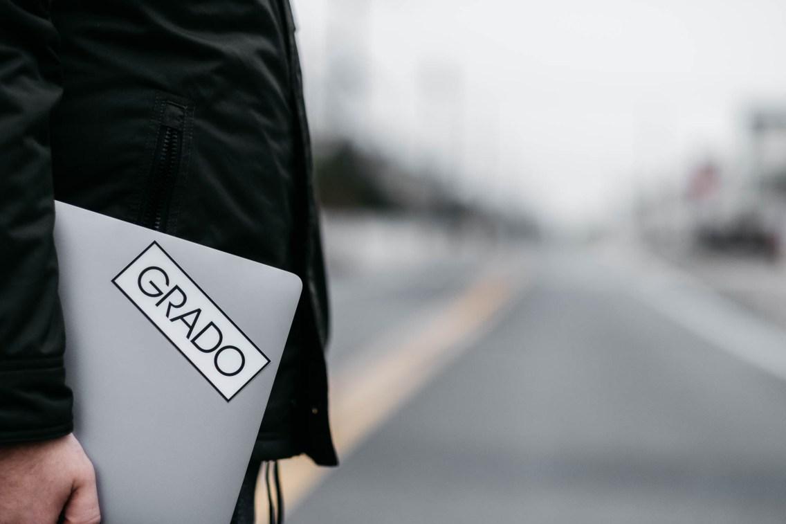 Grado stickers on MacBook outside