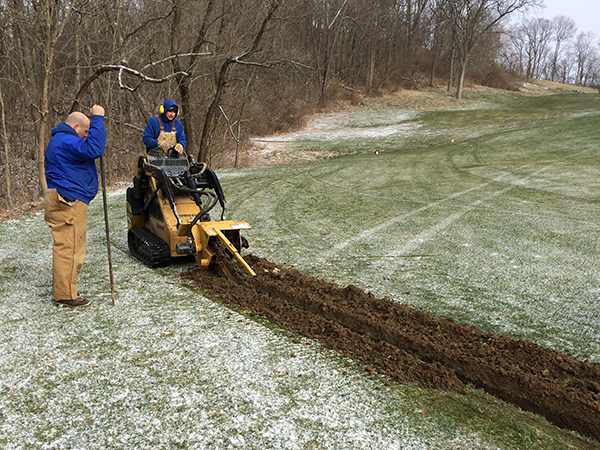 Installing new drain lines in a fairway