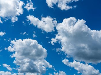 White clouds float across a blue sky.