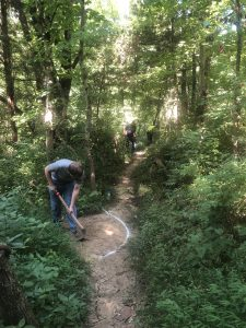 Volunteers work on improving the Mountain Bike Trail at Mitchell Memorial Forest in 2019.