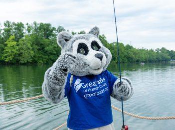 Parky the Raccoon catches a tiny fish at Lake Isabella.