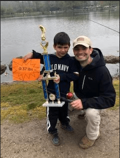 Ryan Knab and his father pose with his trophy.