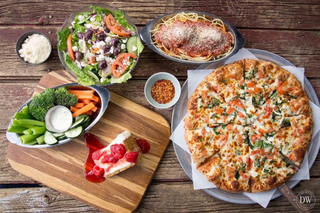 Bird's-eye view of delicious pizza, pasta, salad and more at Venezia's Pizzeria
