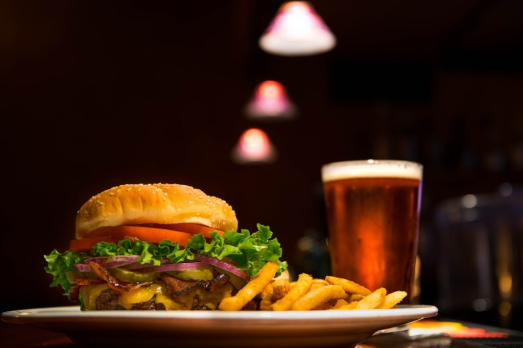 Burger, fries, and glass of beer at a Miller's Ale House fundraising event