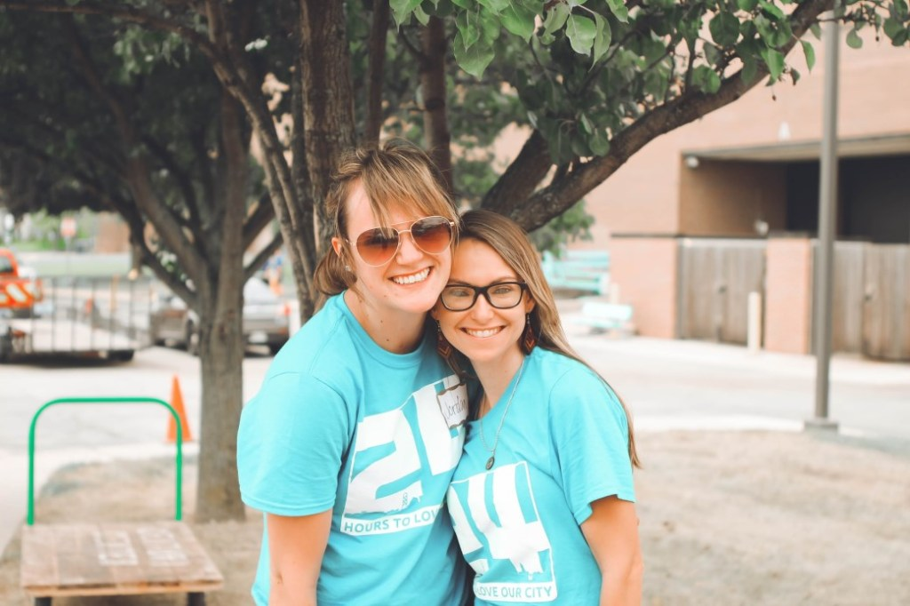 Two smiling women in matching blue t-shirts