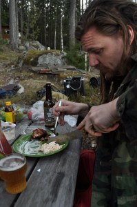 Petri demonstrating proper eating habits at a Finnish cabin.