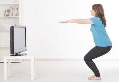 Woman using Virtual Fitness to Exercise