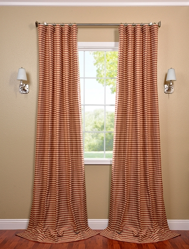 Consider orange window treatments in your bedroom this fall