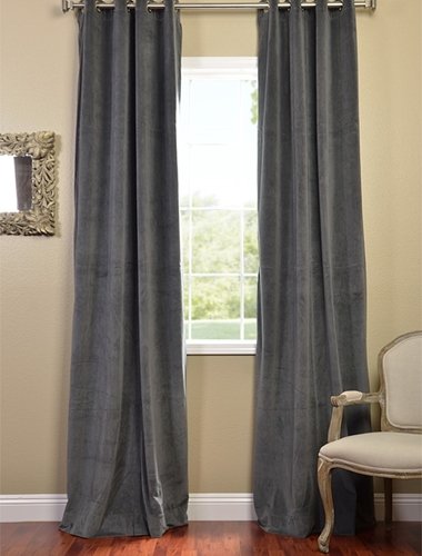 Use black curtains to divide rooms in your studio apartment