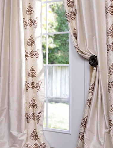Patterned white curtains will add a little bit of design sense to your house where there is none