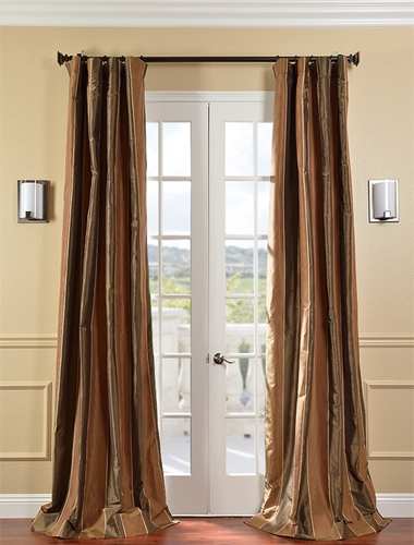Coordinate the drapes and rug in your entryway