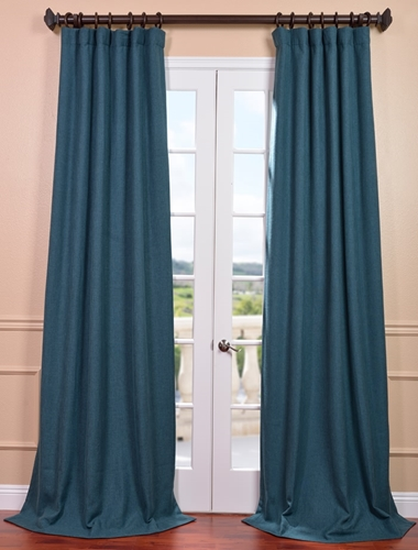 Use curtains to create a bedroom sanctuary