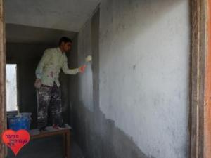 Der Maler an der Arbeit.