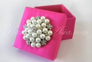 Silk wedding favor box with pearl brooch