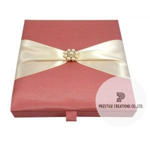 wedding invitation box with pearl brooch