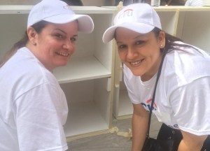 Volunteers Paint at Casa Central