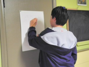 Writing on a vertical surface enhances handwriting mastery!