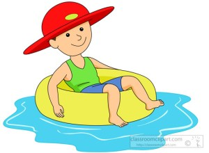 boy-wearing-hat-in-pool-sitting-inner-tube